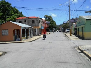 Typical street in Rio San Juan. Lunch time and everything but restaurants takes a two hour lunch break.
