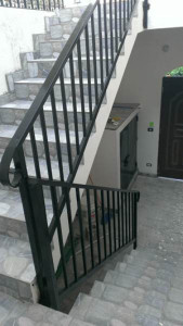 Courtyard Stairs To Upper Level With Custom Ironwork