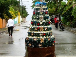 A simple ornament but look closely. You'll notice it just a bunch of tires. First a tractor tire. Then two large truck tires followed up by smaller tires ending up with a motorcycle tire. All placed in the middle of an intersection. No hassles either that's two examples of what simpler is.